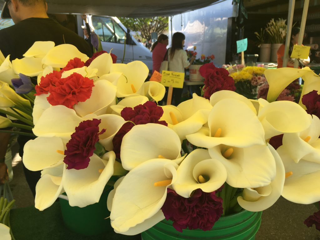 Calla lillies in a farmer's market stall available for sale