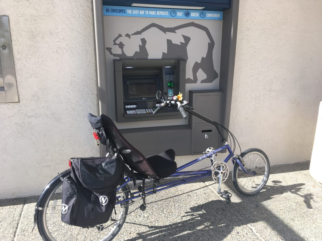 An ATM machine and a bicycle.