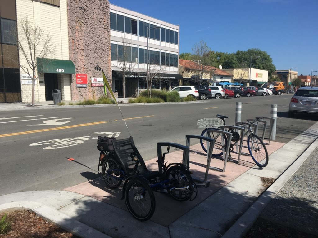 bicycle parking area on California Avenue with a recumbent tricycle and a conventional bike