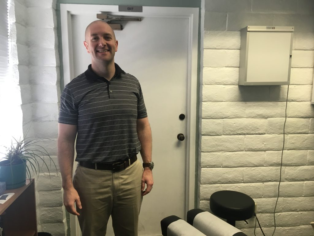 a chiropractor in his treatment room