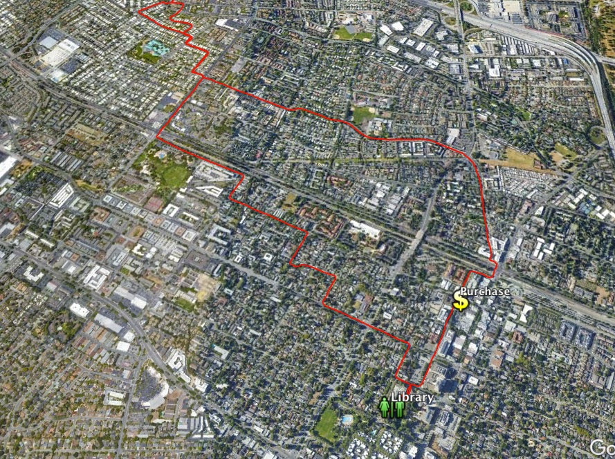 aerial map with a red line showing a bicycling route to and from a library