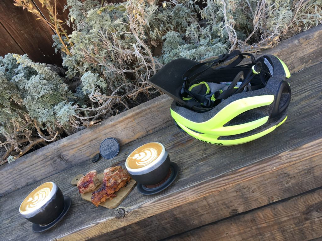 two coffees, a scone and a bicycle helmet